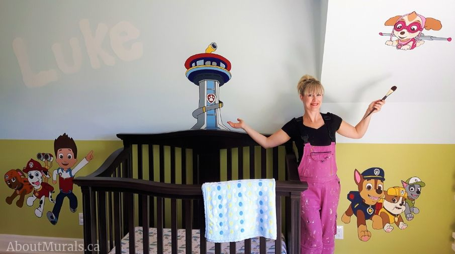 Adrienne Scanlan with her hand-painted Paw Patrol Mural.