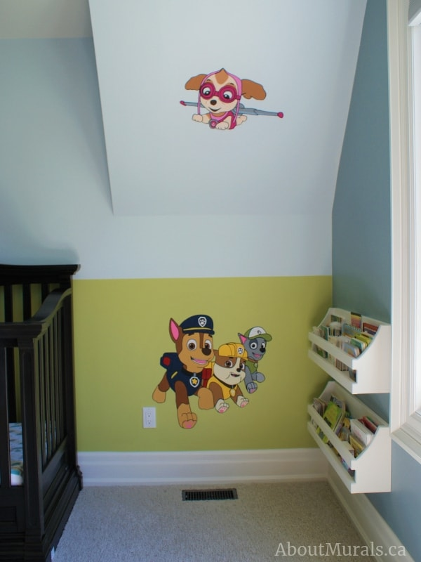 A paw patrol mural featuring Chase, Rubble, Rocky and Skye, painted by Adrienne of AboutMurals.ca