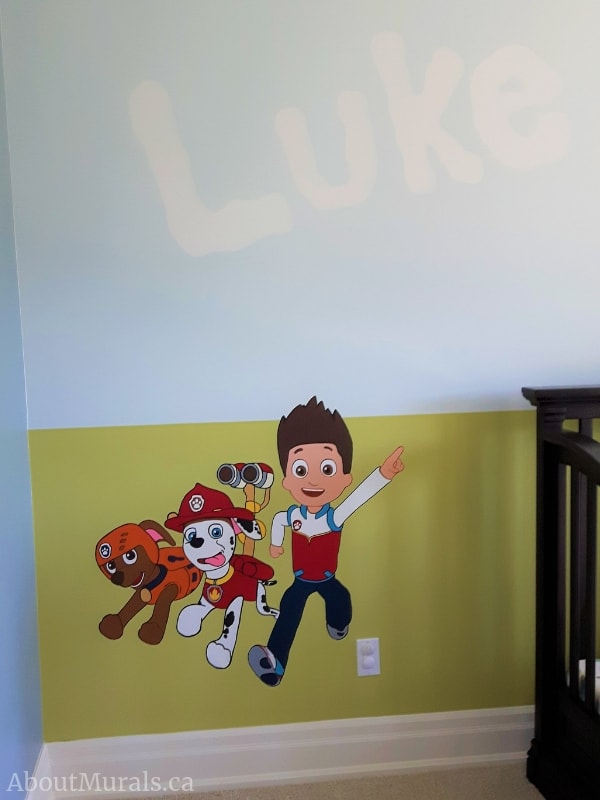 A paw patrol mural featuring Ryder, Marshall and Zuma, painted by Adrienne of AboutMurals.ca