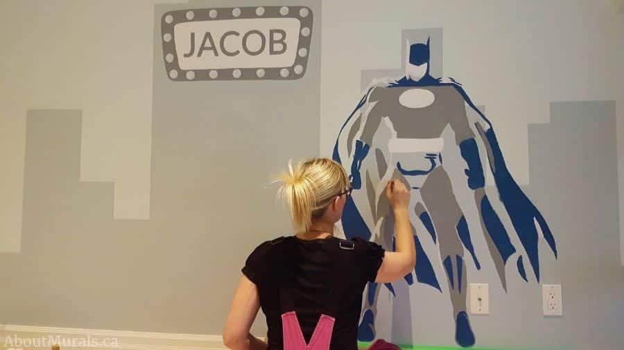 Adrienne of AboutMurals.ca paints batman in her superhero mural