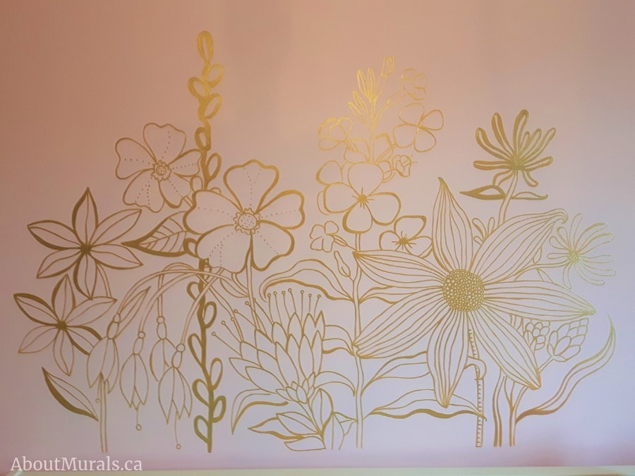 Adrienne of AboutMurals.ca painted these gold flowers on a pink wall in a girl's bedroom